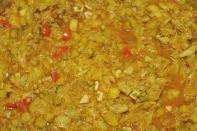 """This is most traditional and homely version of cabbage in Indian kitchens. Though each family makes it differently, here's a simple and basic one – Heat oil in a pan. Add cumin seeds. When they begin to crackle, add salt, red chilli powder, turmeric and coriander powder. Add some hing (asafoetida) over this and give a good stir. Now add chopped cabbage leaves in the pan and mix well. Pour in some water and allow the cabbage to cook. In about 15 minutes the vegetable is ready and can be enjoyed with some nice warm chapatis. """"Creative Commons Cabbage with Potatoes Curry"""" by Biswarup Ganguly is licensed under CC BY 3.0"""