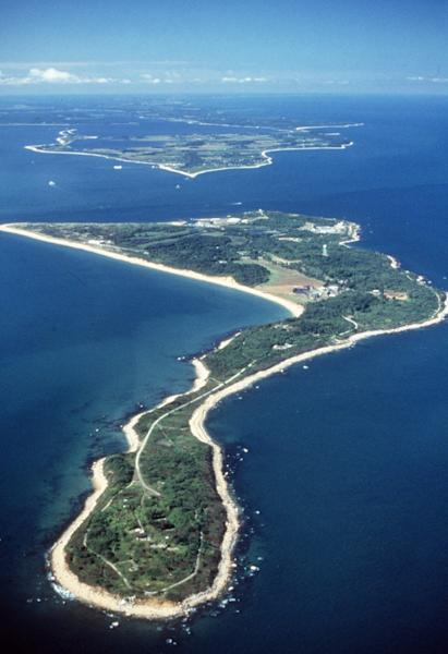FILE - In this undated file photo provided by the U.S. Department of Agriculture, Plum Island is seen from the air in the waters off the northern shore of New York's Long Island. The future of the mysterious island where infectious animal diseases have been studied since the 1950s is about to gain renewed focus. One federal agency is preparing a final report on Plum Island's proposed sale at the same time Long Island officials consider new zoning laws that will prevent any significant development of the 843-acre property should it be sold. (AP Photo/USDA-ARS, File)