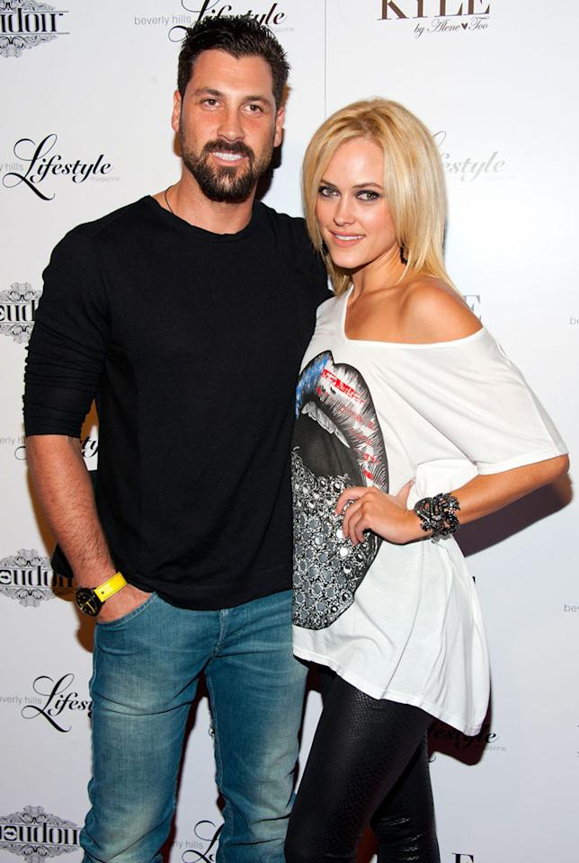 "<b>Maksim Chmerkovskiy & Peta Murgatroyd</b><br>Season 14<br><br>Sometimes a little competition can spark romance! Maks and Peta announced their relationship right after Season 14 wrapped in May of 2012. (A season that Peta won with celeb partner Donald Driver.) It isn't clear when these two started dating during that season, but they've been going strong ever since. Peta even said that there is ""nothing that [she] doesn't like"" about Maks. Cute!"