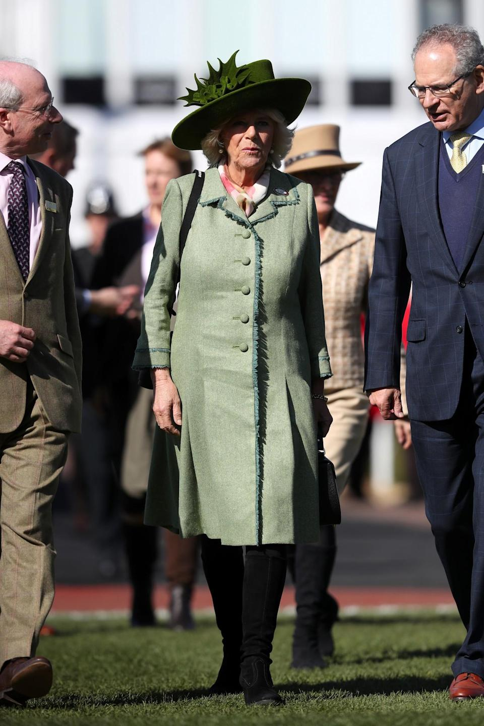 <p>Camilla's gone for two shades of green, including a coat with fringing detail and a hat in a richer shade [Photo: PA] </p>