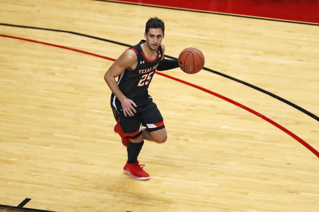 Texas Tech's Davide Moretti (25) dribbles the ball down the court during the first half of an NCAA college basketball game against Kentucky, Saturday, Jan. 25, 2020, in Lubbock, Texas. (AP Photo/Brad Tollefson)