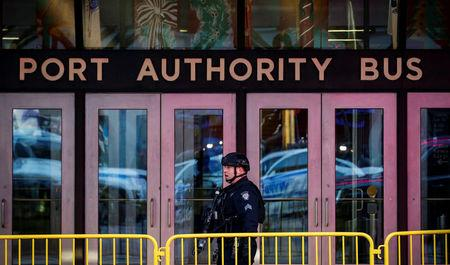 Police officer stands outside the New York Port Authority Bus Terminal, after reports of an explosion, in New York City, U.S. December 11, 2017. REUTERS/Brendan McDermid