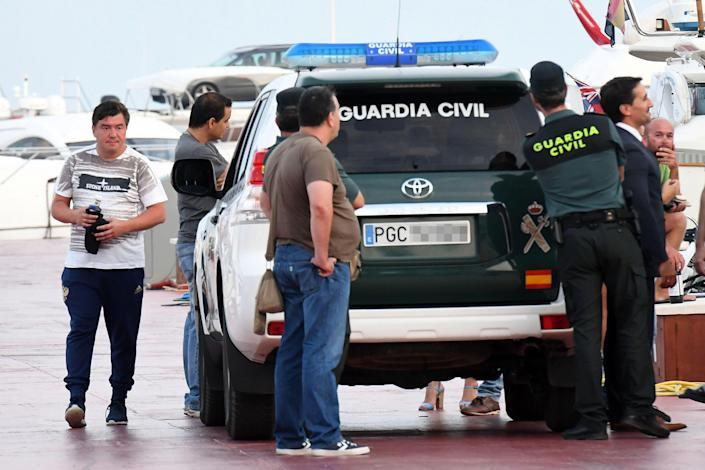 Russian magnate Alexander Grinberg (left), as the Guardia Civil performs a raid on his Marbella yacht on Sept. 26, 2017. (Photo: G Tres Informacion Mas Comunicacion On Line, S.L./Alamy Live News)