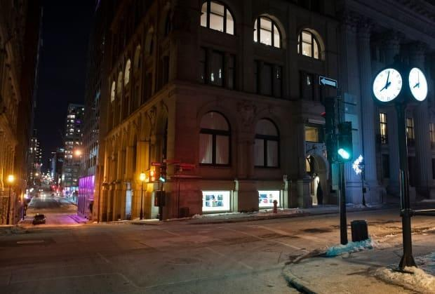 A normally busy corner of Old Montreal sits empty on a Saturday night after the Quebec government enacted an 8 p.m. curfew in January. (Graham Hughes/The Canadian Press - image credit)