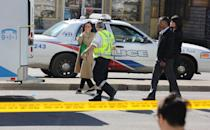 <p>Woman reacts as she is brought to an ambulance to identify a victim in Toronto. Creative Touch Imaging Ltd./NurPhoto via Getty Images </p>