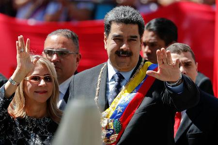 Venezuela's President Nicolas Maduro salutes next to his wife Cilia Flores, during the arrival for a special session of the National Constituent Assembly to present his annual state of the nation in Caracas, Venezuela January 14, 2019. REUTERS/Carlos Garcia Rawlins