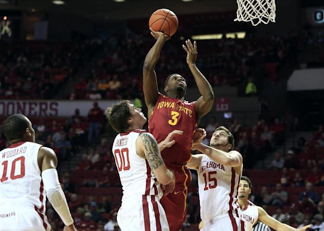 Iowa State forward Melvin Ejim (3) goes to the basket between Oklahoma's Ryan Spangler (00) and Tyler Neal (15) during the first half of an NCAA college basketball game in Norman, Okla. on Saturday, Jan. 11, 2014. (AP Photo/Alonzo Adams)