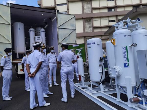 Personnel of the Indian Navy at the launch of the mobile oxygen generation plants.