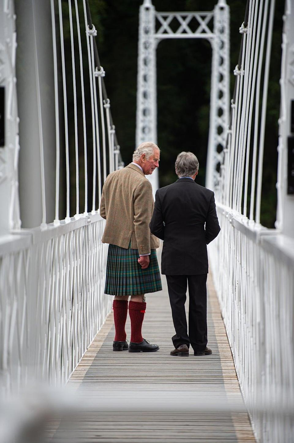Charles with bridges manager, Donald Macpherson (Wullie Marr/DCT Media/PA) (PA Wire)