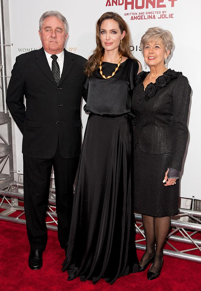 "<a href=""http://movies.yahoo.com/movie/contributor/1800019275"">Angelina Jolie</a> and Brad Pitt's parents, William and Jane, at the New York premiere of <a href=""http://movies.yahoo.com/movie/1810186173/info"">In the Land of Blood and Honey</a> on December 5, 2011."