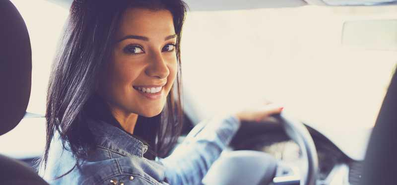 Smiling woman in a vehicle.