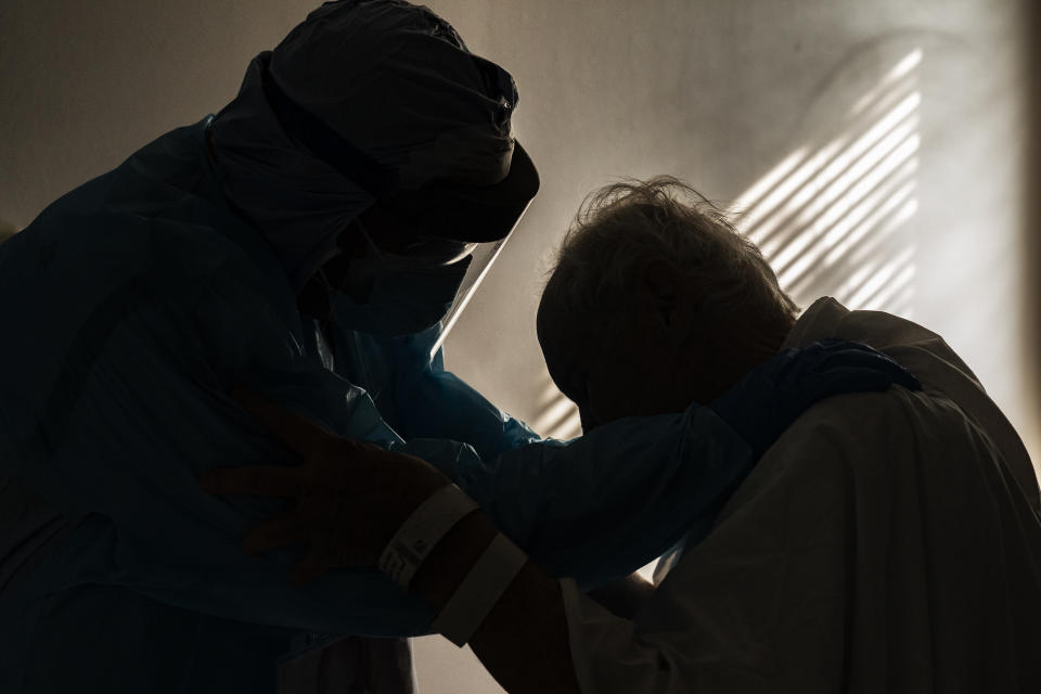 HOUSTON, TX - NOVEMBER 26: (EDITORIAL USE ONLY) Dr. Joseph Varon comforts a patient in the COVID-19 intensive care unit (ICU) during Thanksgiving at the United Memorial Medical Center on November 26, 2020 in Houston, Texas. According to reports, Texas has reached over 1,220,000 cases, including over 21,500 deaths.  (Photo by Go Nakamura/Getty Images)