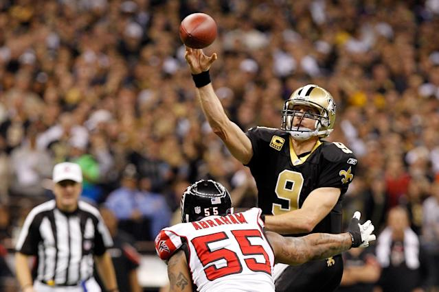 NEW ORLEANS, LA - DECEMBER 26: Quarterback Drew Brees #9 of the New Orleans Saints throws the ball as defensive end John Abraham #55 of the Atlanta Falcons rushes in during the second quarter at the Mercedes-Benz Superdome on December 26, 2011 in New Orleans, Louisiana. (Photo by Chris Graythen/Getty Images)
