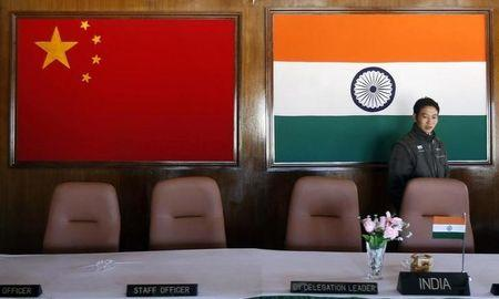 A man walks inside a conference room used for meetings between military commanders of China and India at the Indian side of the Indo China border at Bumla