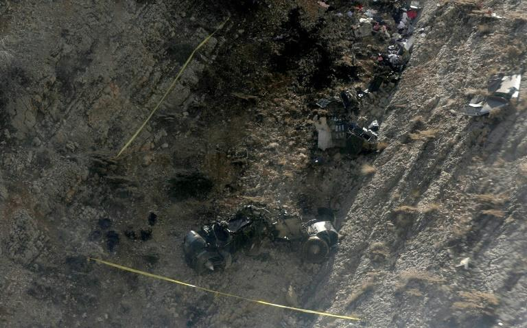 A picture taken March 12, 2018 shows the wreckage of a private jet that crashed a day earlier in southwestern Iran while carrying eight passengers back from a hen party in the United Arab Emirates