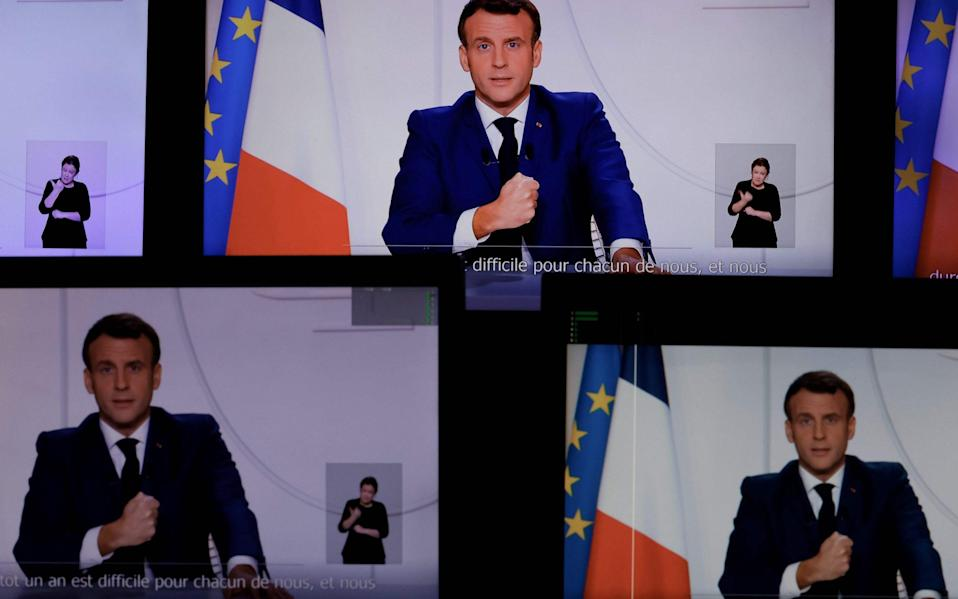 President Emmanuel Macron speaking during a televised address to the Nation on the Covid-19 pandemic and lockdown measures in France - AFP