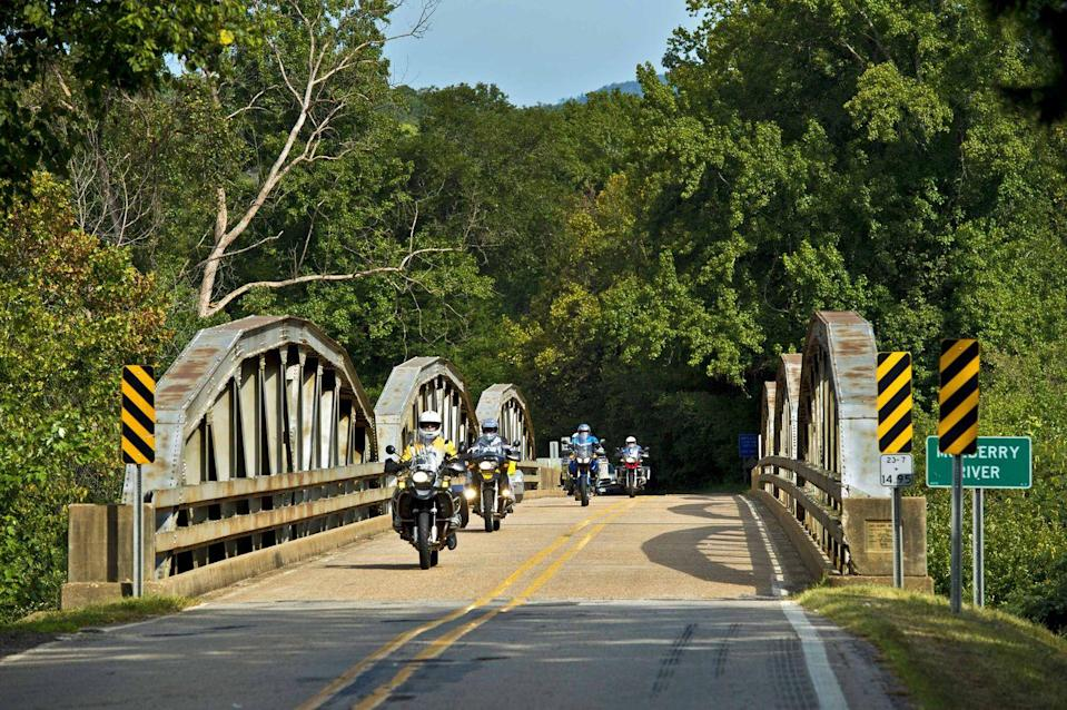 """<p><strong>The Drive: </strong><a href=""""https://www.tripadvisor.com/Attraction_Review-g31834-d13966159-Reviews-Pig_Trail_National_Scenic_Byway-Ozark_Arkansas.html"""" rel=""""nofollow noopener"""" target=""""_blank"""" data-ylk=""""slk:Pig Trail Scenic Byway"""" class=""""link rapid-noclick-resp"""">Pig Trail Scenic Byway</a></p><p><strong>The Scene: </strong>Clocking in at 19 miles long, the Pig Trail Scenic Byway lies within the <a href=""""https://www.tripadvisor.com/Attraction_Review-g28925-d298748-Reviews-Boston_Mountains_Scenic_Loop-Arkansas.html"""" rel=""""nofollow noopener"""" target=""""_blank"""" data-ylk=""""slk:Boston Mountains"""" class=""""link rapid-noclick-resp"""">Boston Mountains</a> region of the <a href=""""https://www.tripadvisor.com/Attraction_Review-g28925-d109478-Reviews-Ozark_Mountains-Arkansas.html"""" rel=""""nofollow noopener"""" target=""""_blank"""" data-ylk=""""slk:Arkansas Ozark Mountains"""" class=""""link rapid-noclick-resp"""">Arkansas Ozark Mountains</a>. Some say the drive got its name because the winding road looks like the corkscrew tail of a pig. Crossing over the Mulberry River and through the Ozark Highlands Trail, this route showcases a riot of colorful foliage during the spring, summer, and fall. </p><p><strong>The Pit-Stop: </strong>Looking for your next camping trip? Stop at the <a href=""""https://www.tripadvisor.com/Hotel_Review-g31804-d1641659-Reviews-White_Rock_Mountain-Mulberry_Arkansas.html"""" rel=""""nofollow noopener"""" target=""""_blank"""" data-ylk=""""slk:White Rock Mountain Recreation Area"""" class=""""link rapid-noclick-resp"""">White Rock Mountain Recreation Area</a> and spend the day climbing the 2,260-foot peak to get a closer look of the surrounding views of the Ozarks. </p>"""