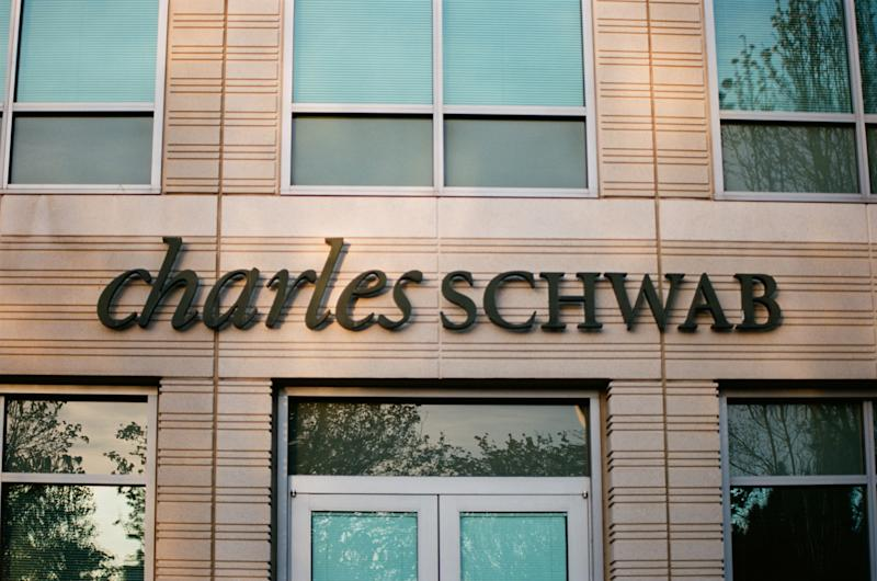 Close-up of sign with logo at Charles Schwab financial adviser branch in Pleasanton, California, March 26, 2018. (Photo by Smith Collection/Gado/Getty Images)
