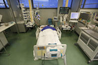 A patient in the COVID-19 Intensive Care Unit of the Papa Giovanni XIII hospital in Bergamo, Italy, Thursday, March 18, 2021. Bergamo's state-of-the-art Pope John XXIII Hospital verged on collapse last March: as army trucks ferried virus dead from the city's over-taxed crematoria, doctors struggled to care for 600 COVID patients, 100 in intensive care. One year later, the picture is much improved: the hospital now is treating fewer than 200 virus patients, just one quarter of those requiring intensive care. (AP Photo/Antonio Calanni)