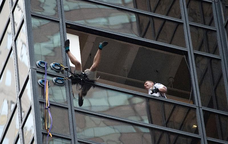 The unidentified man who scaled scaling Trump Tower using suction cups wanted to meet Trump, police say (AFP Photo/Bryan R. Smith)
