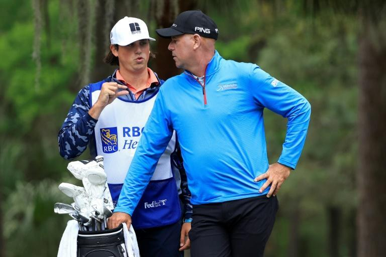 American Stewart Cink talks things over with his son and caddie, Reagan Cink, on the way to the 36-hole lead in the US PGA Tour RBC Heritage