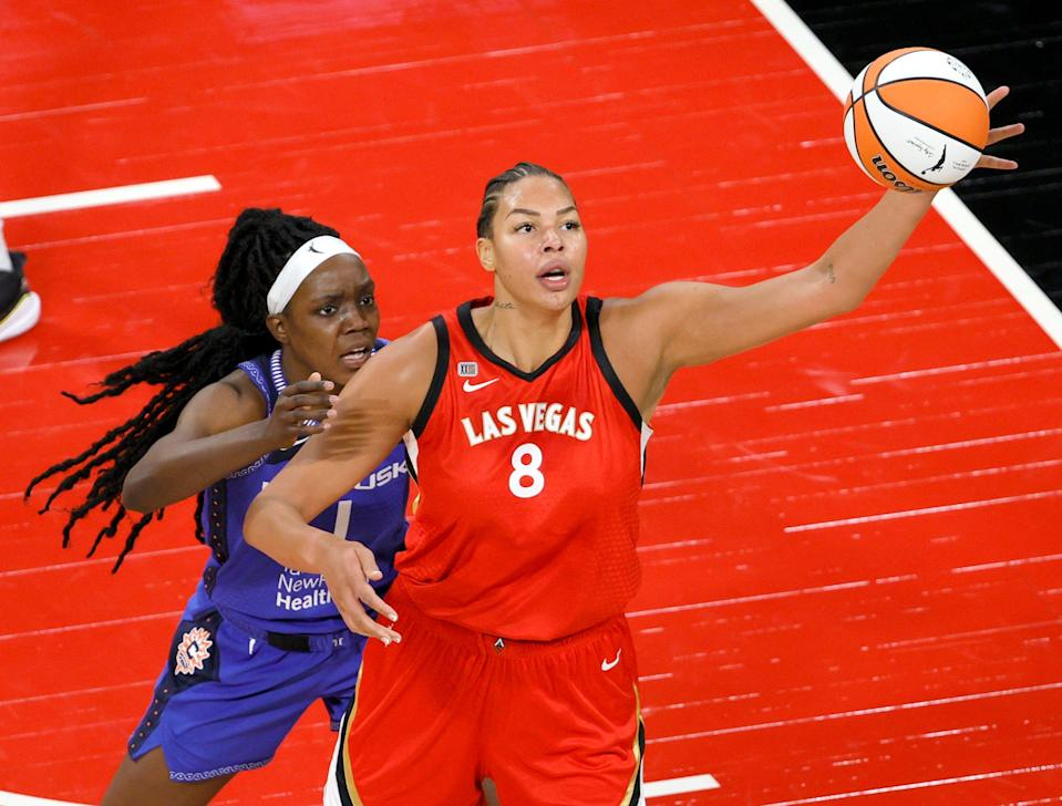 Las Vegas' Liz Cambage (8) catches a pass under pressure from Connecticut's Beatrice Mompremier.