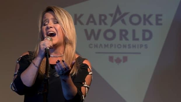 Shannon Niehaus of Edmonton is the reigning Canadian karaoke champion. Qualifying is underway for the Karaoke World Championships (KWC), which is online again this year due to the pandemic. (Submitted by Dustin Jodway - image credit)