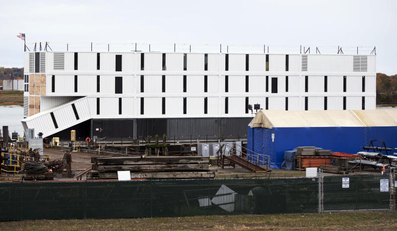FILE - In this Friday, Nov. 1, 2013, file photo, a four-story structure rests on top of a barge in Portland Harbor, in Portland, Maine. It is one of three secretive structures that have online speculation focused on Google. (AP Photo/Robert F. Bukaty, File)
