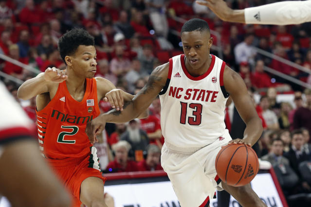 Miami guard Isaiah Wong (2) guards North Carolina State guard C.J. Bryce (13) during the first half of an NCAA college basketball game in Raleigh, N.C., Wednesday, Jan. 15, 2020. (AP Photo/Gerry Broome)