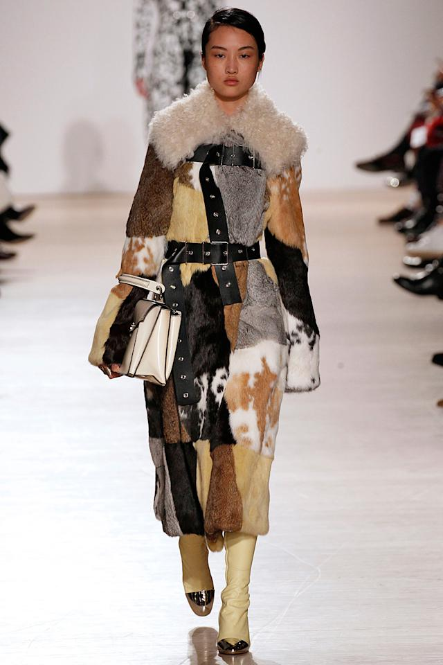 <p>Proenza Schouler's statement patchwork fur and wool collar coat. (Photo: Getty Images) </p>