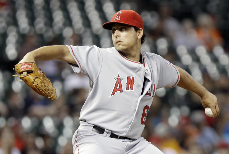 Los Angeles Angels' Jason Vargas delivers a pitch against the Houston Astros in the first inning of a baseball game Friday, Sept. 13, 2013, in Houston. (AP Photo/Pat Sullivan)