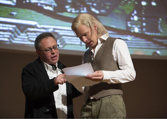 """This image released by Dreamworks Pictures shows director Bill Condon, left, with actor Benedict Cumberbatch on the set of """"The Fifth Estate."""" (AP Photo/Dreamworks Pictures, Frank Connor)"""