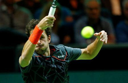 Tennis - ATP 500 - Rotterdam Open - Quarterfinal - Ahoy, Rotterdam, Netherlands - February 16, 2018 Robin Haase of the Netherlands in action against Roger Federer of Switzerland. REUTERS/Michael Kooren