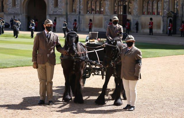 Fell ponies Balmoral Nevis and Notlaw Storm and the Duke of Edinburgh's driving carriage in the Quadrangle ahead of the funeral of the Duke of Edinburgh in Windsor Castle, Berkshire