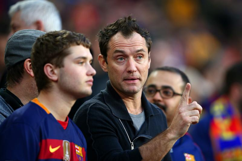 Jude Law takes his seat next to his son Rafferty Law before the start of the La Liga match between FC Barcelona and Real Madrid CF at Camp Nou on April 2, 2016 in Barcelona, Spain. (Photo by Paul Gilham/Getty Images)