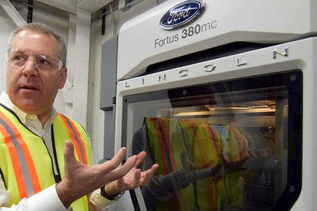 Ford Motor Co global operations president Joe Hinrichs shows off a 3D printer at Ford's Kentucky Truck Plant as the No. 2 U.S. automaker ramps up production of two large SUV models in Louisville, Kentucky, U.S., February 9, 2018. REUTERS/Nick Carey
