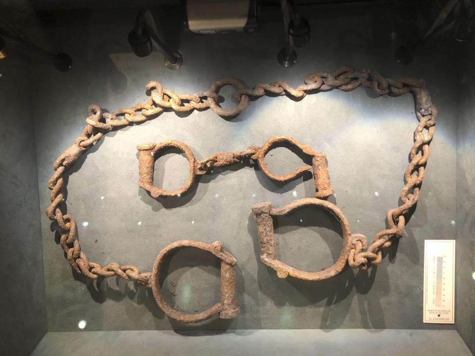 In this Nov. 24, 2019 photo, a set of shackles used to hold enslaved Africans in forts and castles along the coast from Tamale, Ghana, are displayed at the International Slavery Museum in Liverpool, England. The museum seeks to tell the story of the enslavement of people from Africa and how the British city benefited from human bondage. (AP Photo/Russell Contreras)