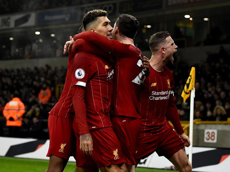 Liverpool celebrate after Roberto Firmino's late winner: Getty