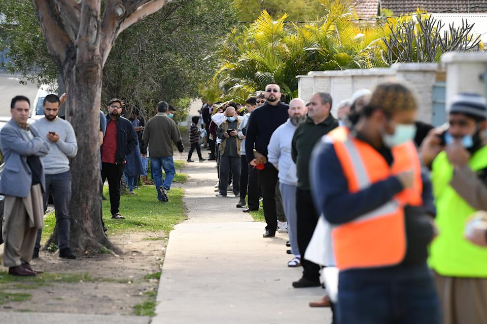 Members of the muslim community wait in line to celebrate the Islamic holiday of Eid al-Adha at the Auburn Gallipoli Mosque in Sydney. Source: AAP