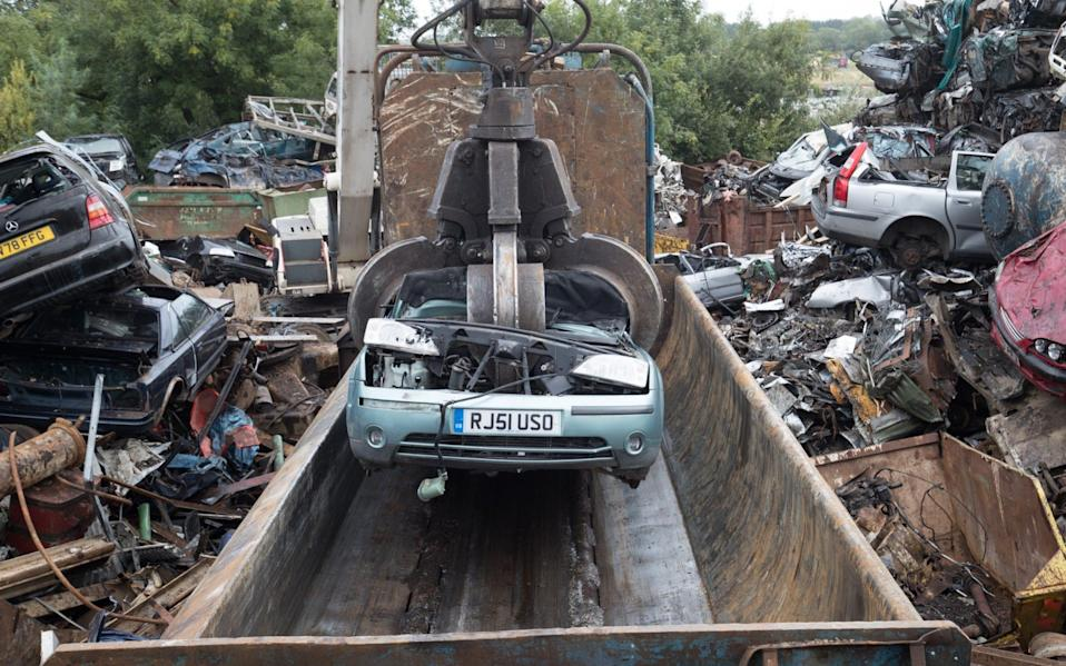 scrap car being placed into a crusher at scrapyard - Matt Cardy/Getty Images