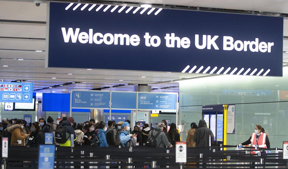 LONDON, ENGLAND - FEBRUARY 11: People queue at UK border control at Terminal 2 at Heathrow Airport on February 11, 2021 in London, England. (Photo by Ian Vogler - Pool/Getty Images) (Photo: Pool via Getty Images)