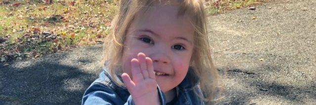 Elena's daughter who has Down syndrome waving.
