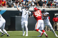 Jacksonville Jaguars quarterback Nick Foles (7) throws a pass as he is pressured by Kansas City Chiefs defensive end Tanoh Kpassagnon (92) during the first half of an NFL football game, Sunday, Sept. 8, 2019, in Jacksonville, Fla. (AP Photo/Stephen B. Morton)