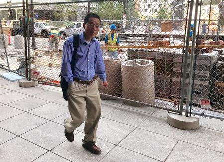 FILE PHOTO - Former Akebia Therapeutics Inc employee Schultz Chan enters the federal courthouse in Boston
