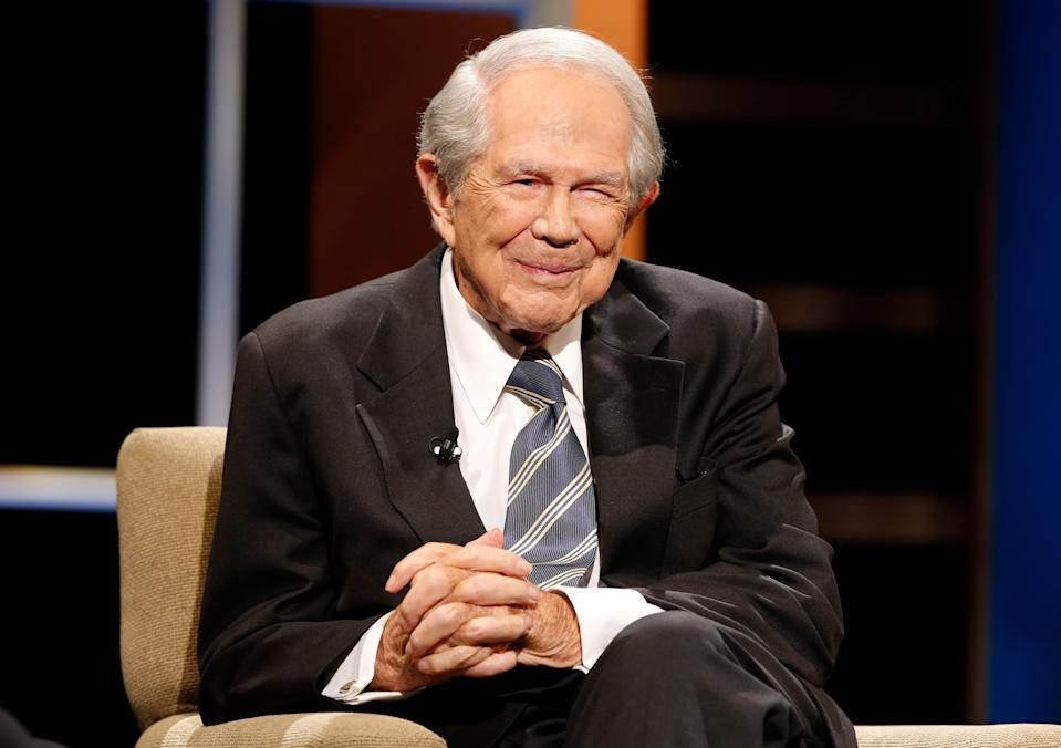 In this Friday, Oct. 23, 2015, photo, the Rev. Pat Robertson poses a question to a Republican presidential candidate during a forum at Regent University in Virginia Beach, Va.