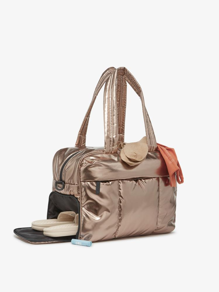 """<h3>Calpak Luka Soft-Side Duffel Bag</h3><br>This showstopping soft-shelled, yet durable tote has a multi-compartment interior and exterior with enough space for a change of clothes (shoes included).<br><br>Shop <a href=""""https://www.calpaktravel.com"""" rel=""""nofollow noopener"""" target=""""_blank"""" data-ylk=""""slk:Calpak"""" class=""""link rapid-noclick-resp"""">Calpak</a><br><br><strong>Calpak</strong> Luka Duffel, $, available at <a href=""""https://go.skimresources.com/?id=30283X879131&url=https%3A%2F%2Fwww.calpaktravel.com%2Fproducts%2Fluka-duffel%2Fbronze"""" rel=""""nofollow noopener"""" target=""""_blank"""" data-ylk=""""slk:Calpak"""" class=""""link rapid-noclick-resp"""">Calpak</a>"""