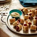 """<p>Busy hands are great for finger foods, making these pigs in a blanket perfect for an afternoon snack and a good source of protein.</p><p><em><a href=""""https://www.womansday.com/food-recipes/food-drinks/recipes/a27972/pigs-in-blanket-recipe/"""" rel=""""nofollow noopener"""" target=""""_blank"""" data-ylk=""""slk:Get the Pigs in Blankets recipe"""" class=""""link rapid-noclick-resp"""">Get the Pigs in Blankets recipe</a>.</em></p>"""
