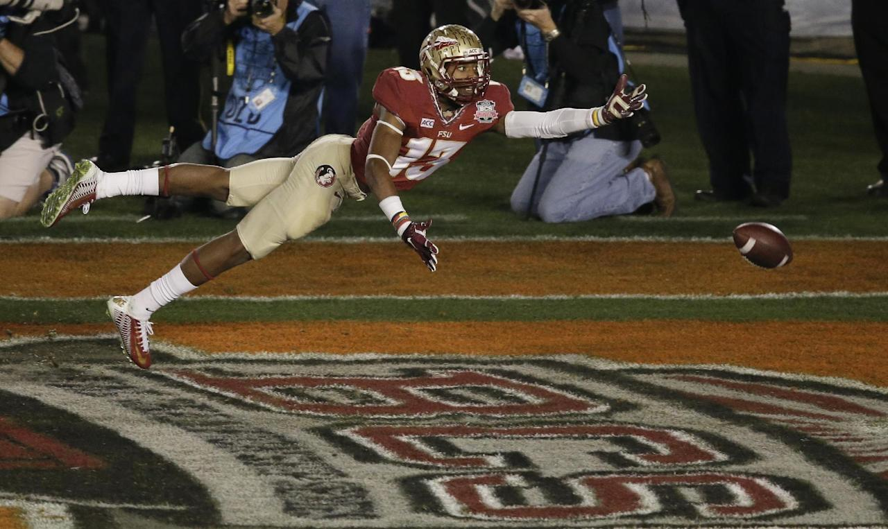 Florida State's Jalen Ramsey can't quite intercept a pass during the second half of the NCAA BCS National Championship college football game against Auburn Monday, Jan. 6, 2014, in Pasadena, Calif. (AP Photo/Gregory Bull)