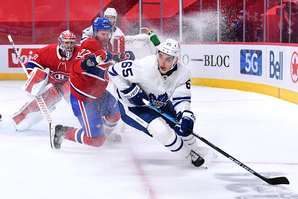 MONTREAL, QC - MAY 25: Brett Kulak #77 of the Montreal Canadiens tries to slow down Ilya Mikheyev #65 of the Toronto Maple Leafs in Game Four of the First Round of the 2021 Stanley Cup Playoffs at the Bell Centre on May 25, 2021 in Montreal, Quebec, Canada. (Photo by Francois Lacasse/NHLI via Getty Images)