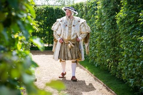 Henry VIII did not wander the maze at Hampton Court. But men in costume sometimes do - Credit: JOHN NGUYEN/JNVISUALS